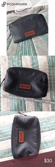 Dooney & Bourke makeup bag/clutch Adorable navy blue D&B pouch! I used it for my makeup/cosmetics bag for my large purses. No flaws on the outside but some makeup spots inside (see pics).   Dimensions shown in pics above. Dooney & Bourke Bags Cosmetic Bags & Cases