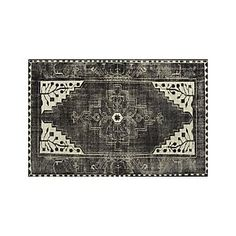 Anice Black Rug from Crate and Barrel - Lovely and almost sinister looking. Wonderful for a someone cultivating a lair with classical stylings.