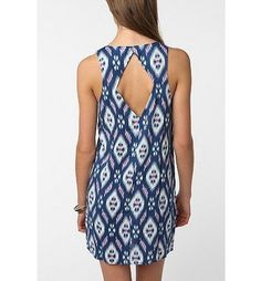 Nom De Plume Dress - I like the cutout on this dress. Not crazy about the pattern for me though.