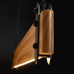 Our industrial linear wood beam LED pendant light is an old-worldly composition of timber and steel contrasted with the clean modern look of embedded LED strip lighting. Linear Lighting, Lighting Design, Club Lighting, Vintage Industrial Lighting, Led Pendant Lights, Pendant Lamps, Luz Led, Wood Beams, Vintage Wood