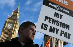A member of the general trade union GMB stands outside The Houses of Parliament in London on November 30, 2011 with a protest placard as public sector staff strike over pensions. Up to two million public sector workers in Britain went on strike over changes to their pensions, after the government responded to slashed growth forecasts with fresh spending cuts.