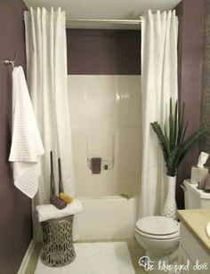 Spa Like Bathroom Remodel - by using two shower curtain panels, it makes the room look bigger.  Hide one waterproof curtain behind the decorative curtain.