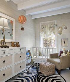 dreamy nursery. balloon shades, globe mobile, jute pouffe, hot air balloon sconce light
