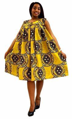 belle robe en tissu pagne africain fleurie couleur jaune ,robe sans manche,décolletée avec bouton au dos,une poche invisible sur le coté.tissu de bonne qualité,qui ne déteint pas au lavage,lavage conseillé à 30° à la machine