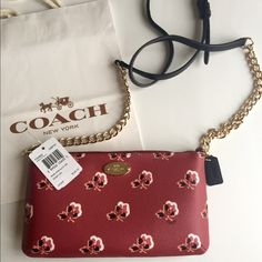 """▵▿ Coach Rose Crossgrain Leather Crossbody ▵▿ The holiday season is quickly approaching & this floral Coach crossbody makes for a perfect gift choice! This 100% authentic Coach purse is brand-new, w/ tags, and comes with a gift bag, gift box, & care instructions.                              Specs: Made of Coated Canvas Approx. 9"""" x 5"""" x 1"""". Adjustable strap. Zip Closure Interior 2 card slots and slip pocket. Fabric Lining. Gold Tone Hardware…"""