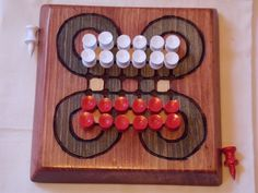 Surakarta (also called Roundabouts, permainan, and dam-daman) is an Indonesian game. Like many games, the goal is to capture as many of the opponents pieces as possible. The method of capturing, however, is unlike any other known board game. Instead of jumping over a piece to capture it like in checkers, or moving into the same space like chess, or performing custodial captures as in tafl games, one must move their capturing piece around the circles at the corners of the board. The only time…