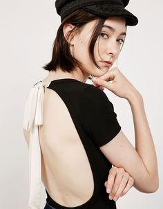 Bodysuit with white bow on back. Discover this and many more items in Bershka with new products every week