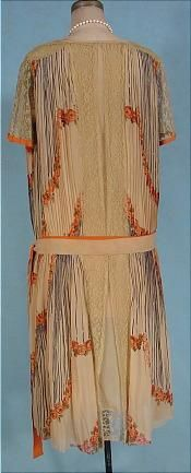 """1926 Deco Tea-colored and Orange Design Crepe Day Dress! I sell few day dresses, of any era, as I usually find them boring. But boring this is not!! My mother bought me the PBS or A series tapes called """"The House of Elliott"""" since she was enamored by the 20's costumes in the program. No doubt this dress would have been in the show if they had known about it! Tea colored thin silk crepe fabric in two layers. The under sheath which you see in the front panel, hemmed with wide lace, and then…"""