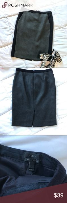 J. Crew No 2 Pencil Skirt In excellent used condition. Absolutely no flaws. 100% wool. Lining 100% polyester. Gray and navy. The front it gray with panels of navy. The back is navy with a slit. J. Crew Skirts Pencil