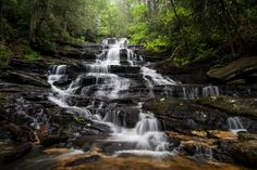 John Cothron posted a photo:  Spring foliage at Minnehaha Falls near Lake Rabun, Georgia. Minnehaha Falls are on Falls Branch between its headwaters on Stony Mountain and where it empties into Lake Rabun. They are approximately 100 ft. high, and arguably the most beautiful waterfall in North Georgia. It is easily accessible off Bear Gap Road near Lake Rabun in the town of Lakemont. One of the interesting features of Minnehaha is the bed of quartz at the foot of the falls.  (0.5 sec at f/11)…