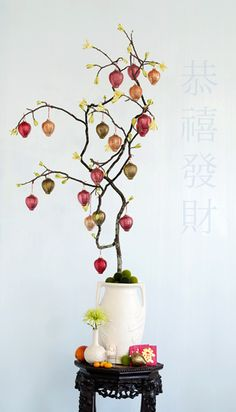 """Chinese New Year   This """"forced"""" tree branch is made quite elegant with the addition of mercury glass lantern ornaments. The traditional paper lanterns used on the fifteenth day of the Chinese New Year for the Lantern Festival, are bright, colorful, and in many different shapes and sizes. See more at http://www.thedecoratedtree.blogspot.com/2010/02/year-of-tiger.html"""