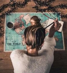 Map girl messy bun wanderlust road trip vacation planning holiday