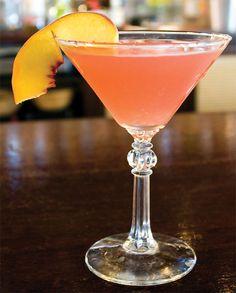 a stoli peach cocktail:  2 oz. Stoli peach vodka   Splash of cranberry juice   Splash of orange juice   Splash of Champagne   Peach slice     for you Nicole