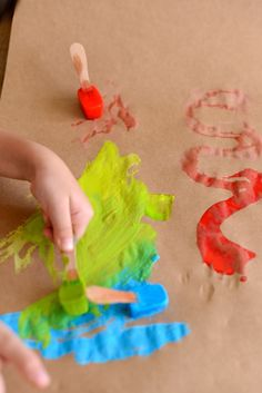 Paint ice!  Freeze cubes with watered down paint with a craft stick as a handle