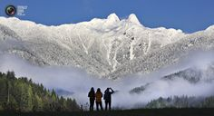 Visitors to Capilano Park look out at the pointed peaks of The Lions covered in snow in North Vancouver. ANDY CLARK/REUTERS