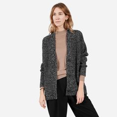 A super comforting knit cardigan with a slouchy silhouette and contrasting buttons. Spun in Italy, the fabric is a generous thick knit with a soft hand-feel.