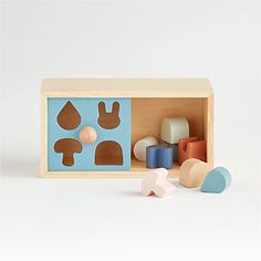 This wooden puzzle box is a timeless wooden toy that stimulates imagination. It features smooth, colorful pieces that encourage hands-on play while helping little ones develop their senses. Wooden Toy Crates, Wooden Puzzle Box, Wooden Baby Toys, Wooden Puzzles, Toddler Fine Motor Activities, Educational Activities For Preschoolers, Games For Kids, Diy For Kids, Rainbow Bedding