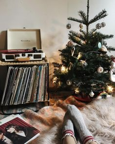 Cozy and vintage Christmas decorating with a mini tree, records, and fur!
