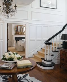 foyer with staircase - great molding! Love how they painted/stained top rail and steps a dark brown, black color! - My-House-My-Home Balustrades, Banisters, Black Banister, White Staircase, Staircase Molding, Foyer Staircase, Black Stairs, Entryway Stairs, Staircase Runner