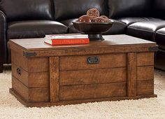 Inspired by Old World trunks, these designs allude to heritage. A large, cedar–lined compartment, shelves and drawers create an abundance of storage. The rustic chestnut finish is distressed and enhanced with antique corner brackets and drop pull hammered hardware. Drawers are constructed with dovetail joinery, wood–on–wood guides and are dust–proofed and smoothly finished. Built with corner blocks. Asian hardwoods and oak veneers.