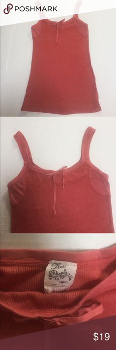 Free People Tank Top Free People tank top size medium. Measurements of tank top from on top of the shoulder to bottom of shirt is approx. 28 inches and from under left arm to under the right arm is approx. 14.5 inches. No trades Free People Tops Tank Tops