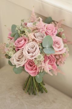 Bouquet of keano, faith and menthe roses with astilbe, astrantia and eucalyptus.