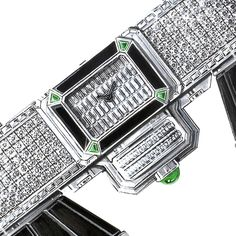 Set directly on the bridge of the binoculars is a discreet timepiece shaped in an octagonal emerald cut and set with 48 baguette-cut diamonds and emeralds in each corner (POA).