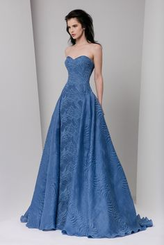 Steel Blue semi sweetheart macramé evening dress with an overskirt in printed gazar.