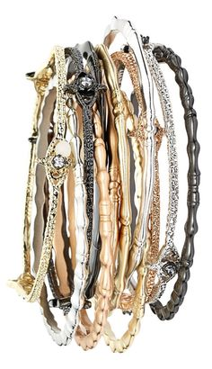Totally crushing on this mixed metals bangles set that's detailed with texture, shine and glints of crystal.