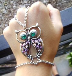 Welcome! This is a new, handmade slave bracelet, consisting of a large owl pendant and silver plated chain. The owl is decorated with lavender jewel