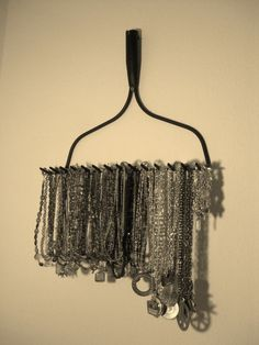 Necklaces on a rake.