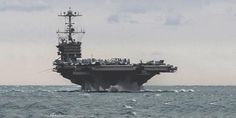 the aircraft carrier uss harry s. truman. | US says Iran firing rockets near American warships provocation