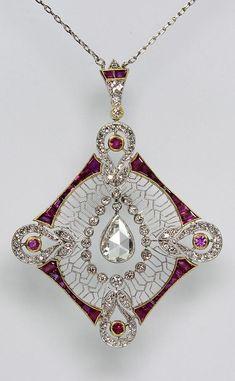 An Edwardian platinum, diamond and ruby pendant. An Edwardian platinum, diamond and ruby pendant. Bijoux Art Nouveau, Art Nouveau Jewelry, Jewelry Art, Gemstone Jewelry, Fine Jewelry, Fashion Jewelry, Jewelry Design, Jewelry Armoire, Fashion Rings
