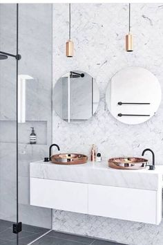 Whether you use it on your floors, in the shower, on your sink, or simply in smaller accessories, marble will instantly elevate the look and feel of your bathroom. And it doesn't have to be white, either.