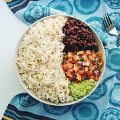 "exiehalie: ""Dinner tonight was a bit Mexican inspired: brown rice, black beans, tomato salsa and guac. Also had a head of cos lettuce with it (made little lettuce boats). """