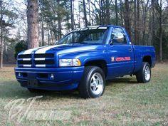 Blue Dodge Ram Truck white racing stripe hood