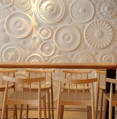 So doing this. This was an application done on a restaurant wall.....but how cool would it be to do a smaller version on a wall in the home?   The big circles are ceiling medallions and the smaller ones could be those wooden accents you find in the lumber section of the home improvement store?   Put them all up and then paint the entire wall the color you want.