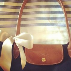 Love the bow on the Longchamp. Will be doing this.