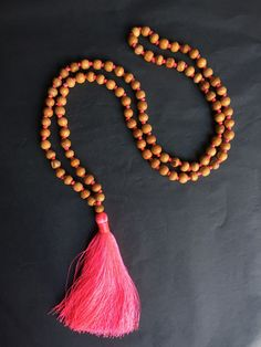 Available online: Our handmade BALI SILK TASSEL NECKLACE (Colour: Neon Pink)