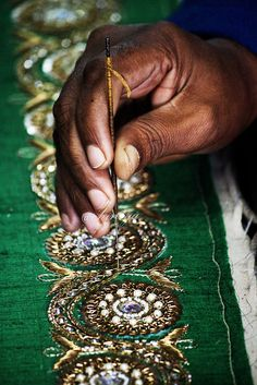 """Zardosi literally means """"sewing with gold"""" and is originally a Persian art form. It involves creating designs with gold, silver and colorful metal threads. Tambour Beading, Tambour Embroidery, Indian Embroidery, Ribbon Embroidery, Beaded Embroidery, Embroidery Stitches, Embroidery Patterns, Zardosi Embroidery, Crazy Quilting"""