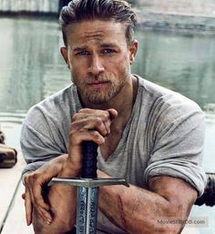 Charlie Hunnam doing his brooding King Arthur impression. Yup, works for me.