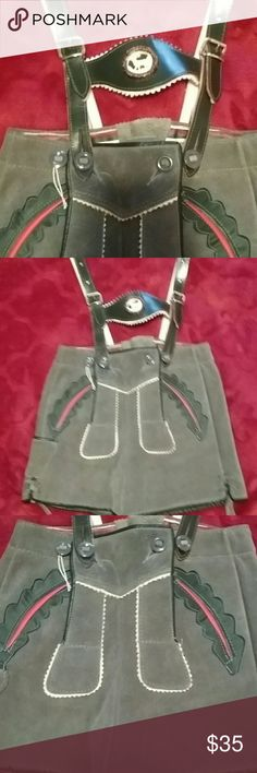 AUTHENTIC GERMAN LEDERHOSE. Childs size, genuine leather. Thick, suede Size not listed, measurements are 11 inches side to side around waist. 11 inches long. Adjustable straps 11 inches to to button done up. PERFECT CONDITION. lederhosen Shorts