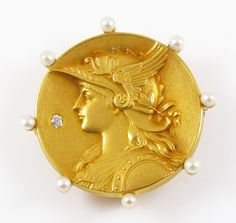 Lovely 14k gold Art Nouveau circular pearl Athena diamond brooch watch pin. This brooch was elegantly created depicting Athena the Greek Goddess of Wisdom. The outer edge of the pin has 8 prong set seed pearls, and in the center is a shimmering inset accent diamond.  Presented in excellent condition