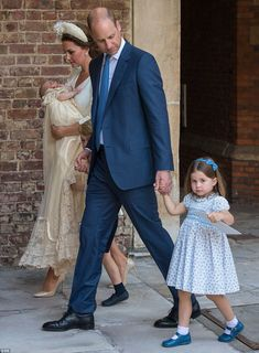 Prince William holds his daughter Princess Charlotte's hand as the family leaves St James'...
