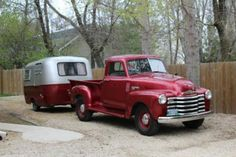 Cherry red and silver boler 1953 Chevy 1300 PU.