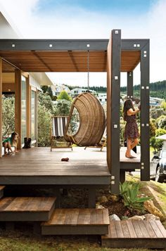 Studio 19, a student program at Auckland's Unitec Institute of Technology, designed the Onemana Holiday Home in a coastal town on New Zealand's North Island on a sloped plot of land. Working with the students allowed the couple to afford a custom-built home, which was built on-campus over the course of 12 months. The outdoor deck, which includes a wicker chair swing, is level to the home's floor making it a natural extension of the interior. Photo courtesy of Simon Devitt