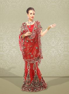 Fascinating Maroon Net Embroidered #Lehenga Choli #bridallehenga #weddinglehengas #ethnicwear #womenapparel #womenfashion