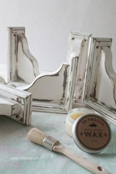 DIY: How to Get a Farmhouse Paint Finish - using stain, Vaseline, paint and sandpaper. This post shows how to create salvaged and weathered farmhouse wood look using new wood - via Lolly Jane