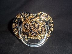 BLINKY'S Leopard Print rhinestone pacifier with crystal bling. $40.00, via Etsy.
