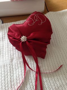 A gift for a friend on her wedding day ring bearer cushion